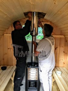 Installation Of The Heater Inside Of The Outdoor Barrel Sauna