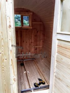 Installing The Inside Of The Outdoor Barrel Sauna