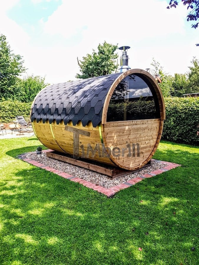 Outdoor barrel sauna with the panorama window