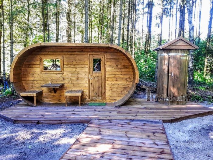 Wooden sauna and an outdoor shower