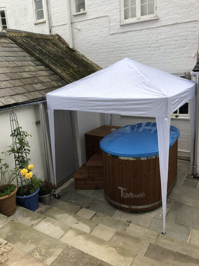 Oval hot tub for 2 persons with fiberglass liner, stephen, bridport, united kingdom (1)