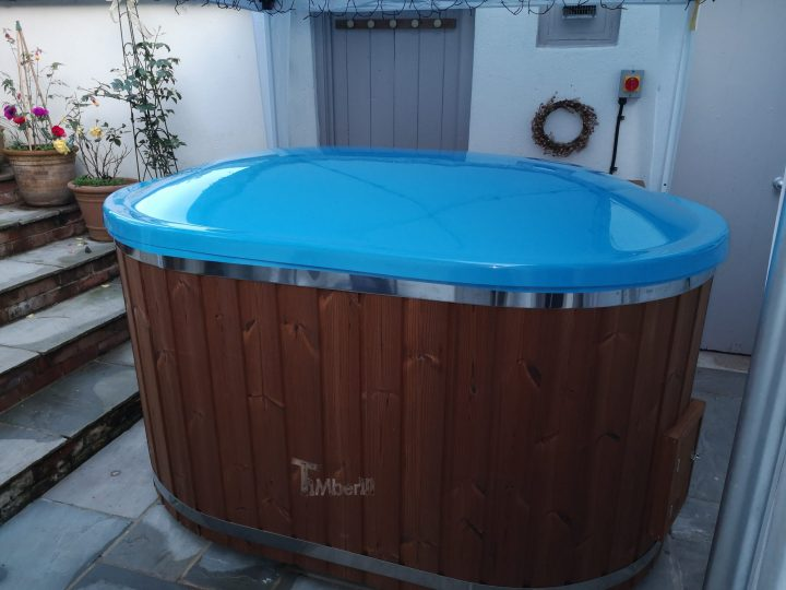 Oval hot tub for 2 persons with fiberglass liner, stephen, bridport, united kingdom (2)