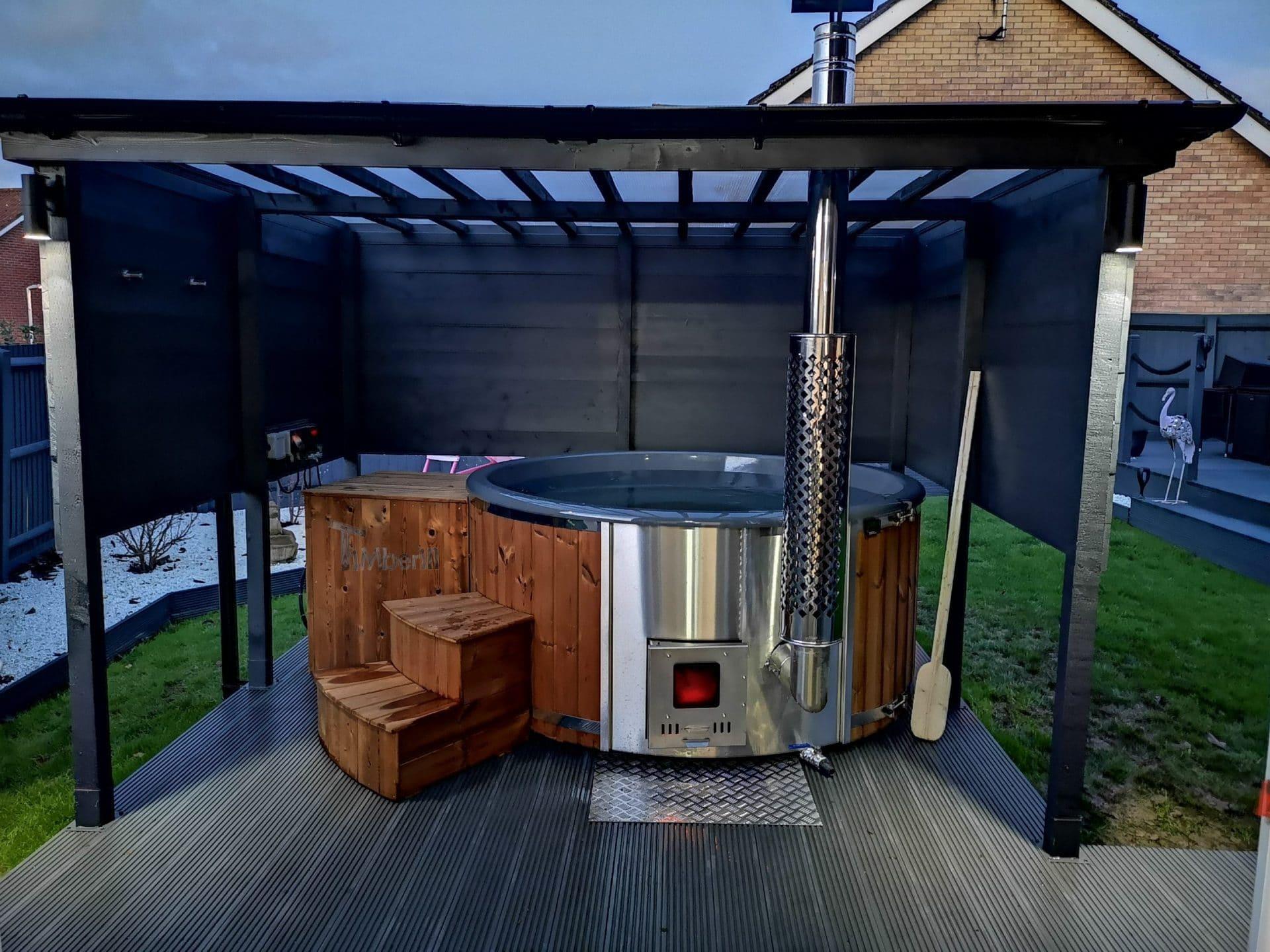Wood burning fiberglass hot tub with integrated stove Wellness Royal Andrew Wellingborough United Kingdom scaled